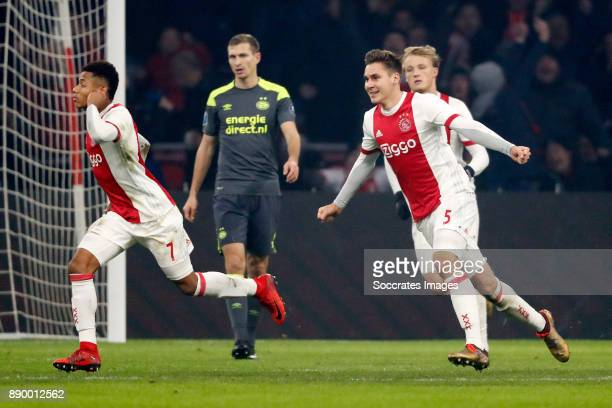 David Neres of Ajax Maximilian Wober of Ajax Celebrate his goal during the Dutch Eredivisie match between Ajax v PSV at the Johan Cruijff Arena on...
