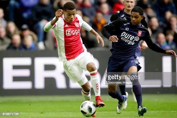 David Neres of Ajax Michael Maria of FC Twente during the Dutch Eredivisie match between Ajax v Fc Twente at the Johan Cruijff Arena on February 11...