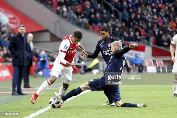 David Neres of Ajax Michael Maria of FC Twente Richard Jensen of FC Twente during the Dutch Eredivisie match between Ajax Amsterdam and FC Twente...