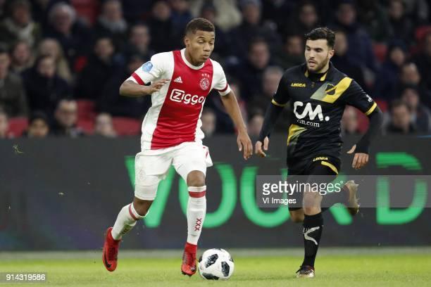 David Neres of Ajax Mounir El Allouchi of NAC Breda during the Dutch Eredivisie match between Ajax Amsterdam and NAC Breda at the Amsterdam Arena on...