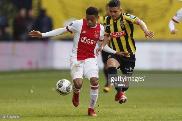 David Neres of Ajax Navarone Foor of Vitesse during the Dutch Eredivisie match between Vitesse Arnhem and Ajax Amsterdam at Gelredome on March 04...