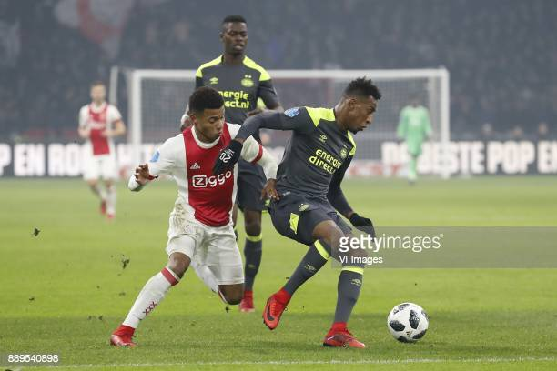 David Neres of Ajax Nicolas IsimatMirin of PSV Joshua Brenet of PSV during the Dutch Eredivisie match between Ajax Amsterdam and PSV Eindhoven at the...
