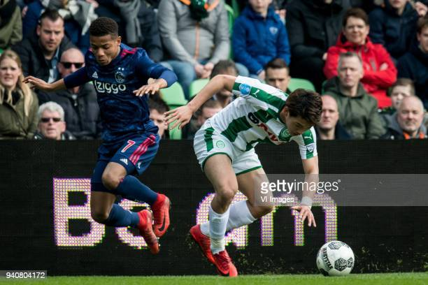David Neres of Ajax Ritsu Doan of FC Groningen during the Dutch Eredivisie match between FC Groningen and Ajax Amsterdam at Noordlease stadium on...