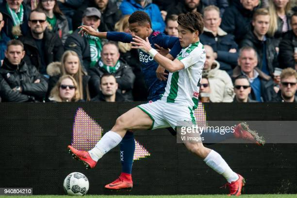 David Neres of Ajax, Ritsu Doan of FC Groningen during the Dutch Eredivisie match between FC Groningen and Ajax Amsterdam at Noordlease stadium on...