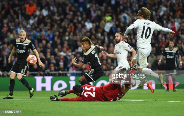 David Neres of Ajax scores his team's second goal past Thibaut Courtois of Real Madrid during the UEFA Champions League Round of 16 Second Leg match...
