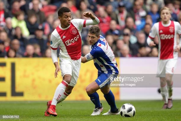 David Neres of Ajax Stijn Schaars of SC Heerenveen during the Dutch Eredivisie match between Ajax v SC Heerenveen at the Johan Cruijff Arena on March...