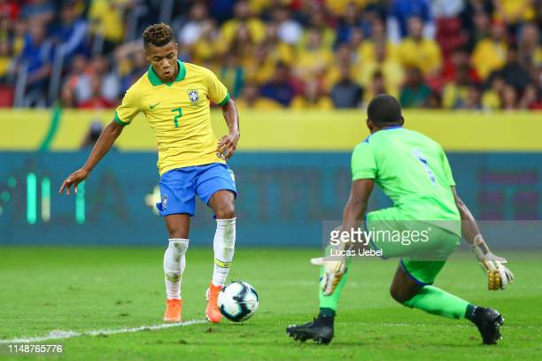 David Neres of Brazil battles for the ball against Luis Lopez of Honduras during the match Brazil v Honduras at BeiraRio Stadium on June 9 in Porto...