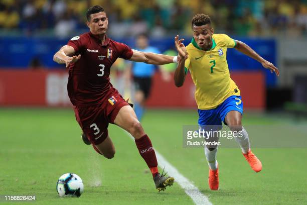 David Neres of Brazil fights for the ball with Yordan Osorio of Venezuela during the Copa America Brazil 2019 group A match between Brazil and...