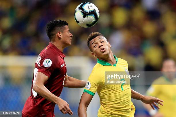 David Neres of Brazil heads the ball against Ronald Hernandez of Venezuela during the Copa America Brazil 2019 group A match between Brazil and...