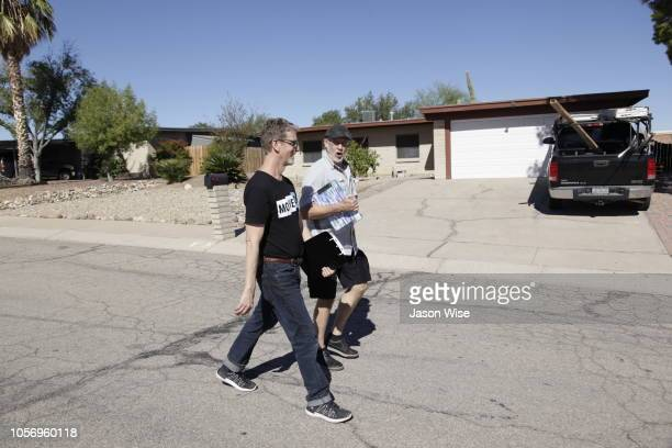 David Nevins and George Rowe of MoveOn canvass for Ann Kirkpatrick on November 3 2018 in Tucson Arizona