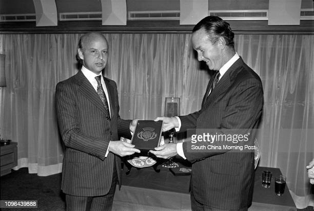 David Newbigging Chairman of Jardine Matheson presenting a souvenir to his staff Jeremy Brown at the farewell party of Mr Brown 15DEC78