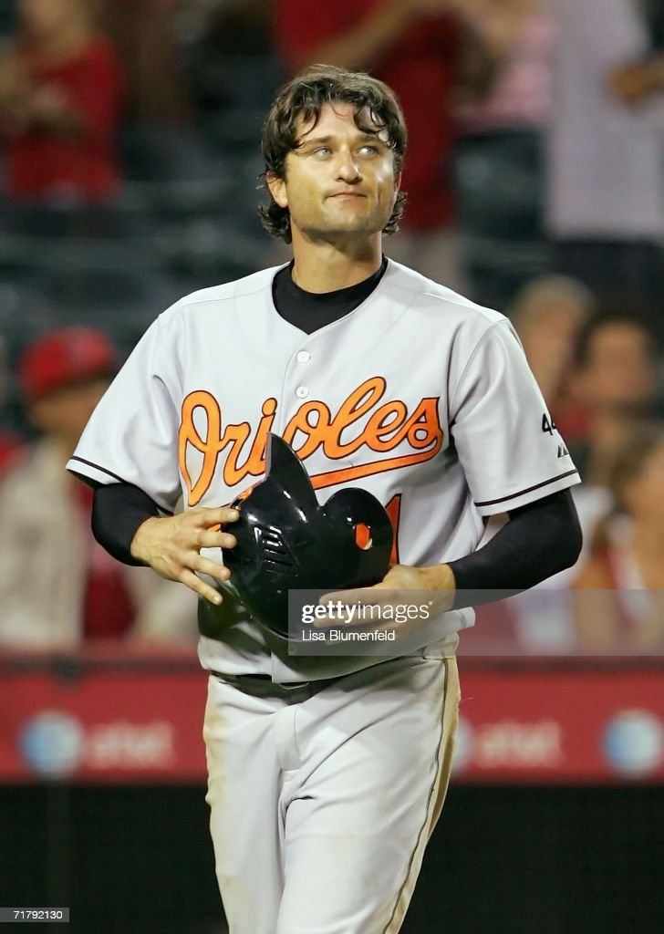 David Newhan #11 of the Baltimore Orioles walks back to the dugout after being tagged out in the tenth inning against the Los Angeles Angels of Anaheim on September 5, 2006 at Angel Stadium in Anaheim, California. The Angels won 5-2.