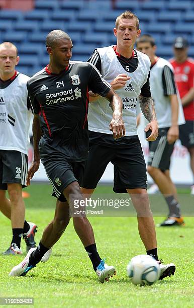 David Ngog and Daniel Agger of Liverpool attend a training session at the Perbadanan Stadium on July 15 2011 in Kuala Lumpur Malaysia