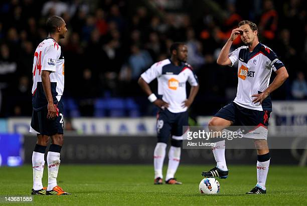 David Ngog and Kevin Davies of Bolton Wanderers look dejected after conceding a third goal during the Barclays Premier League match between Bolton...