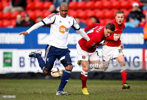 David Ngog of Bolton holds off the challenge of Mark Gower of Charlton during the npower Championship match between Charlton Athletic and Bolton...