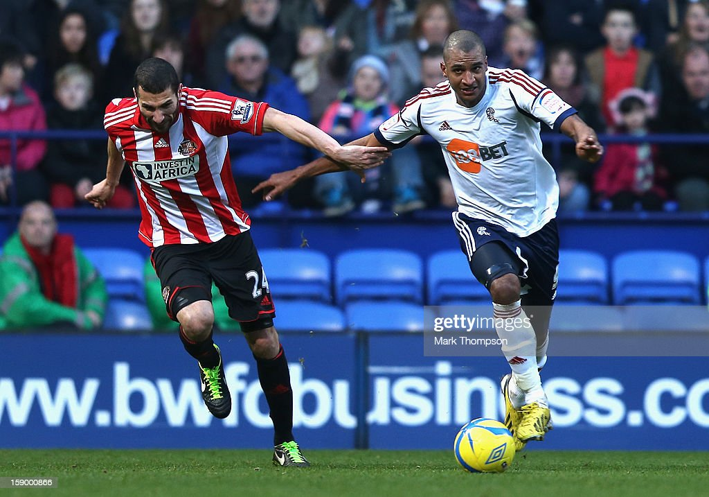 David N'Gog of Bolton Wanderers competes with Carlos Cuellar of Sunderland during the FA Cup with Budweiser Third Round match between Bolton Wanderers and Sunderland at the Reebok Stadium on January 5, 2013 in Bolton, England.