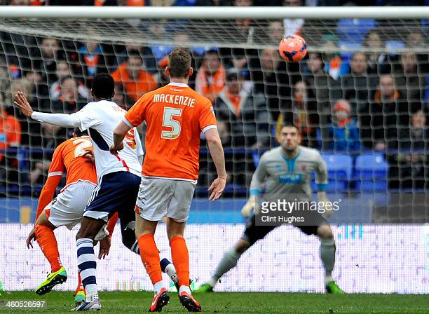 David Ngog of Bolton Wanderers scores the first goal of the game during the Budweiser FA Cup Third Round match between Bolton Wanderers and Blackpool...