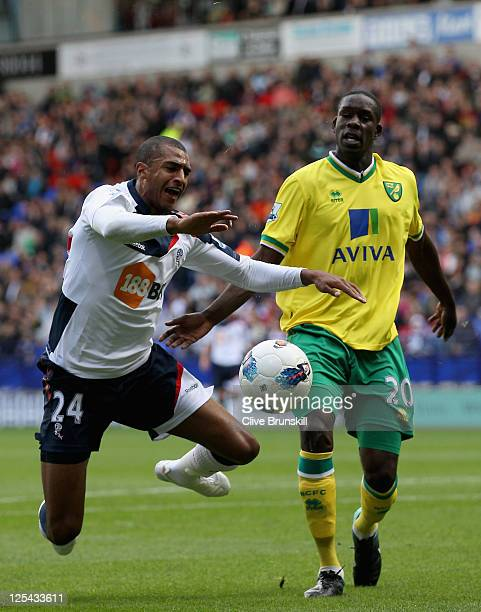 David Ngog of Bolton Wanderers wins a penalty as he is fouled by Leon Barnett of Norwich City during the Barclays Premier League match between Bolton...