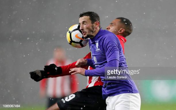 David N'Gog of Budapest Honved battles for the ball in the air with Kire Ristevski of Ujpest FC during the Hungarian OTP Bank Liga match between...
