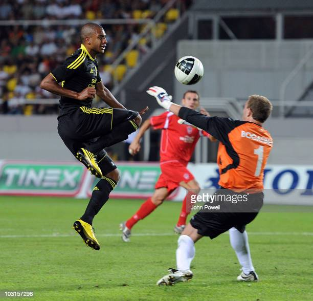 David N'Gog of Liverpool beats Rabotnicki goalkeeper Bogatinov Martin to score the opening goal during the UEFA Europa League Qualifying Round match...