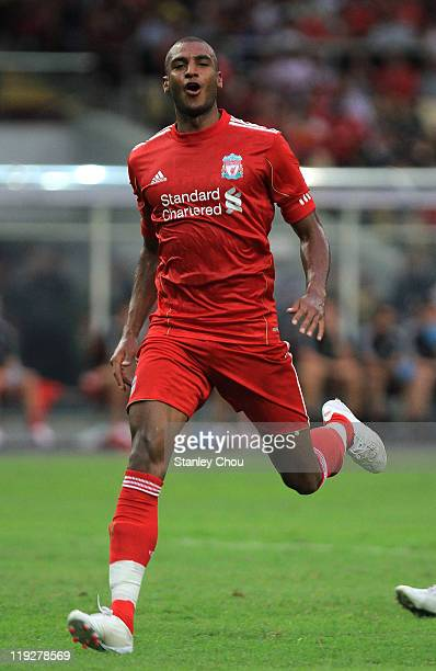 David Ngog of Liverpool celebrates after scoring against Malaysia during the preseason friendly match between Malaysia and Liverpool at the Bukit...
