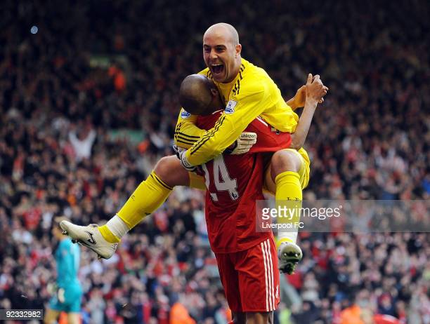 David Ngog of Liverpool celebrates with keeper Pepe Reina after scoring a goal for Liverpool during the match between LiverpooL FC and Manchester...
