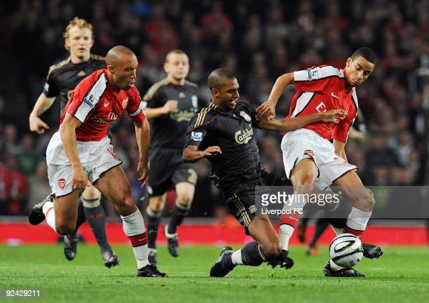 David Ngog of Liverpool competes with Mikael Silvestre and Craig Eastmond both of Arsenal during the match between LiverpooL FC and Arsenal during...