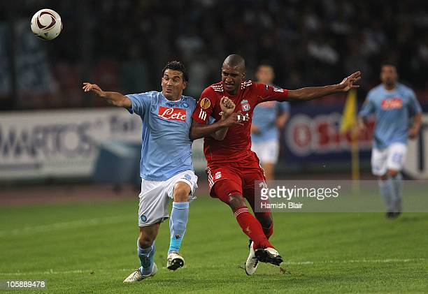 David Ngog of Liverpool contests with Salvatore Aronica of Napoli during the UEFA Europa League match between SSC Napoli and Liverpool played at...