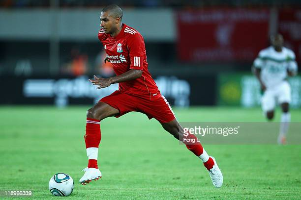 David N'Gog of Liverpool controls the ball during the preseason friendly match between Guangdong Sunray Cave and Liverpool at Guangdong Provincial...