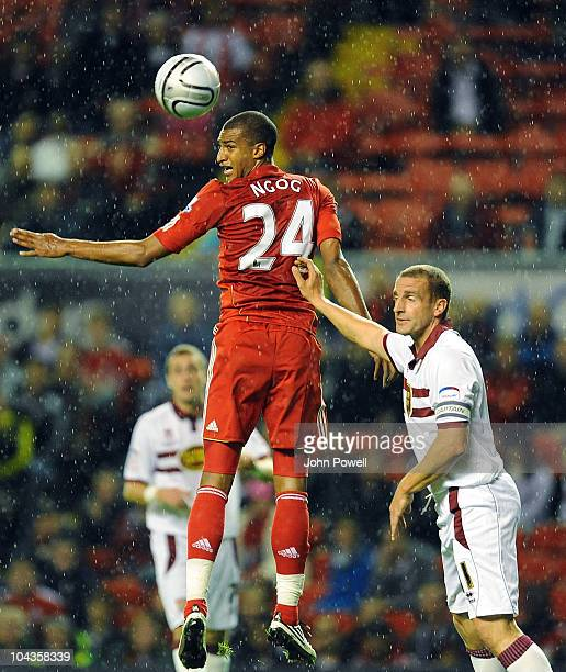 David Ngog of Liverpool gets above Andrew Holt of Northampton Town during the Carling Cup 3rd round game between Liverpool and Northampton Town at...