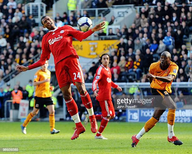 David Ngog of Liverpool goes up for a header during the Barclays Premier League match between Hull City and Liverpool at KC Stadium on May 9 2010 in...