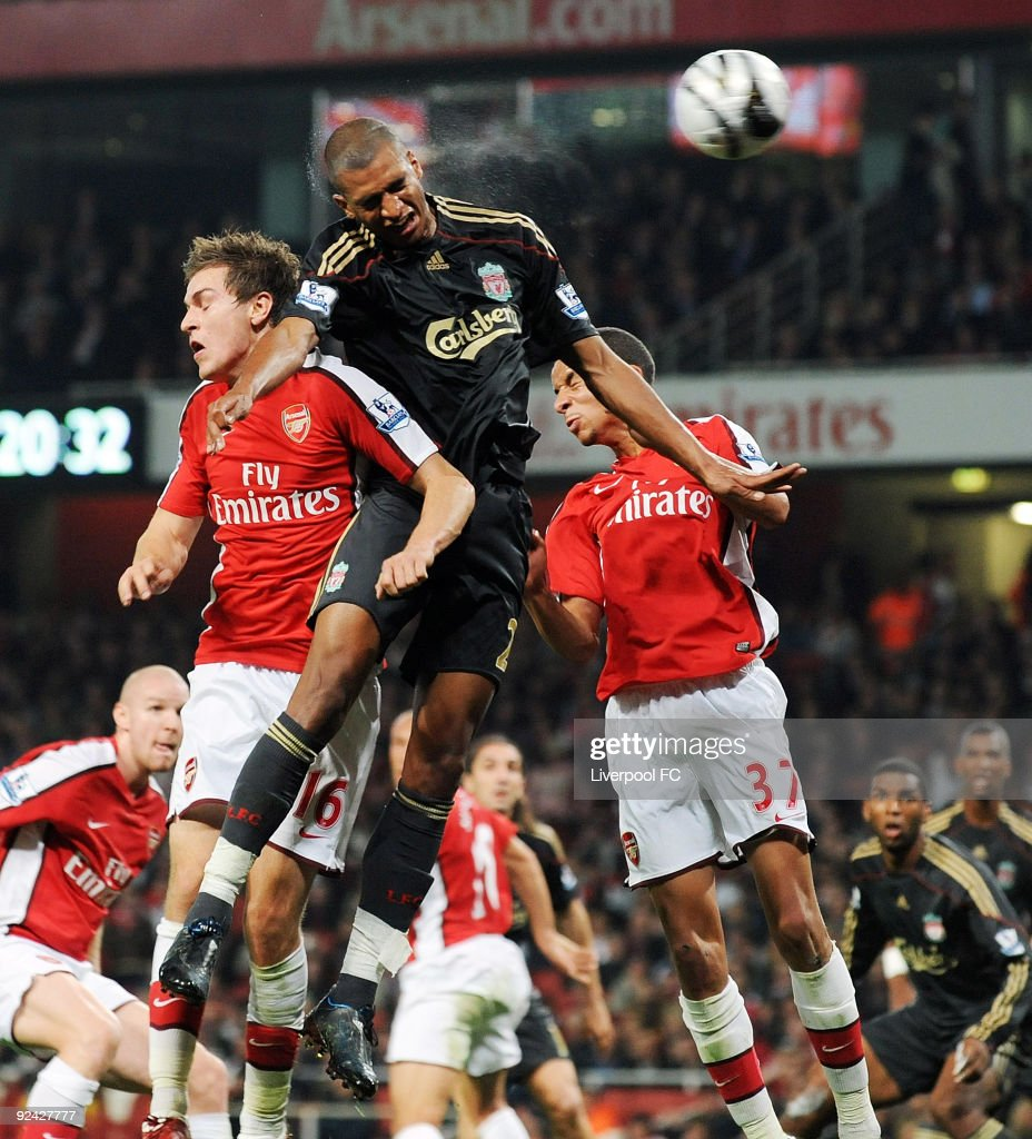 David Ngog (C) of Liverpool headers the ball as Aaron Ramsey (L) and Craig Eastmond (R) both of Arsenal go up too during the match between LiverpooL FC and Arsenal during the Carling Cup Fourth round at Emirates Stadium on October 28, 2009 in London, England.