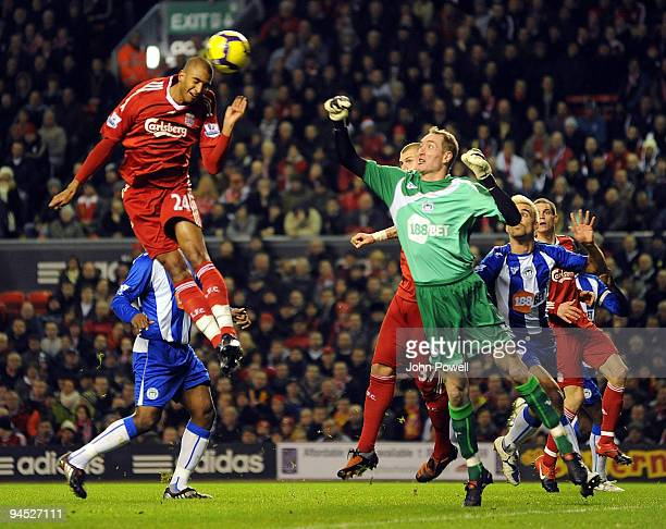 David Ngog of Liverpool heads a goal past Chris Kirkland of Wigan during the Barclays Premier League match between Liverpool and Wigan Athletic at...