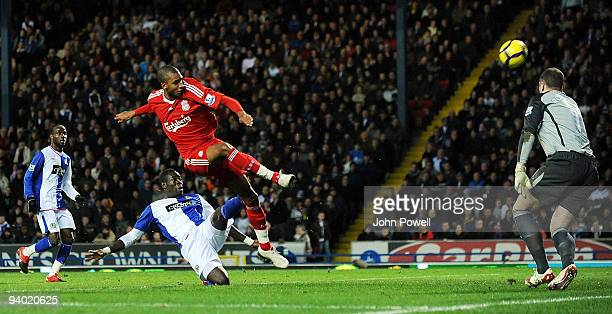 David Ngog of Liverpool hits the cross bar in the second half during the Barclays Premier League match between Blackburn and Liverpool at Ewood Park...