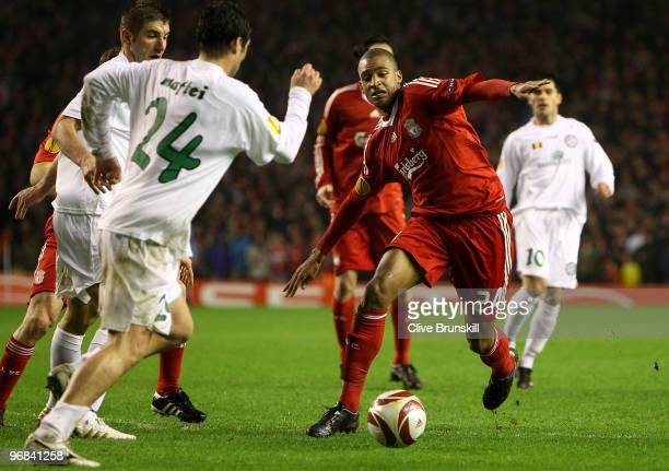 David Ngog of Liverpool in action with Vasile Maftei of Unirea Urziceni during the UEFA Europa League Round 32 first leg match between Liverpool and...