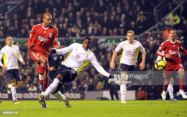 David Ngog of Liverpool is taken down in the area by Sebastian Bassong of Tottenham Hotspur for a penalty during the Barclays Premier League match...