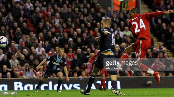 David Ngog of Liverpool scores his team's second goal during the Barclays Premier League match between Liverpool and West ham United at Anfield on...