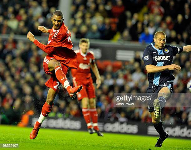 David Ngog of liverpool scores the second goal during the Barclays Premier League match between Liverpool and West ham United at Anfield on April 19...