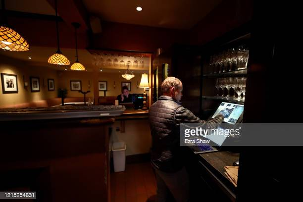 David Nichol the owner of Sociale puts an order in that he received via his computer into the restaurants ordering system on March 27 2020 in San...