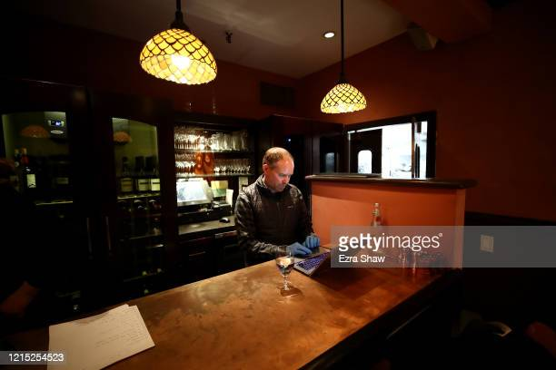 David Nichol the owner of Sociale takes orders via his computer on March 27 2020 in San Francisco California Sociale is working with a staff of only...
