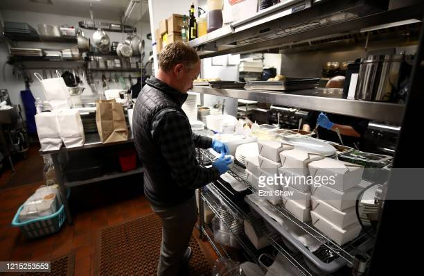 David Nichol the owner of Sociale works in the kitchen with a small staff on March 27 2020 in San Francisco California Sociale is working with a...