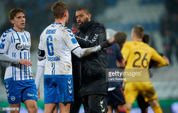 David Nielsen head coach of AGF Aarhus in discussion with Jeppe Tverskov of OB Odense after the Danish Alka Superliga match between OB Odense and AGF...