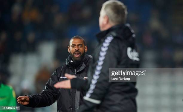 David Nielsen head coach of AGF Aarhus in discussion with Kent Nielsen head coach of OB Odense during the Danish Alka Superliga match between OB...