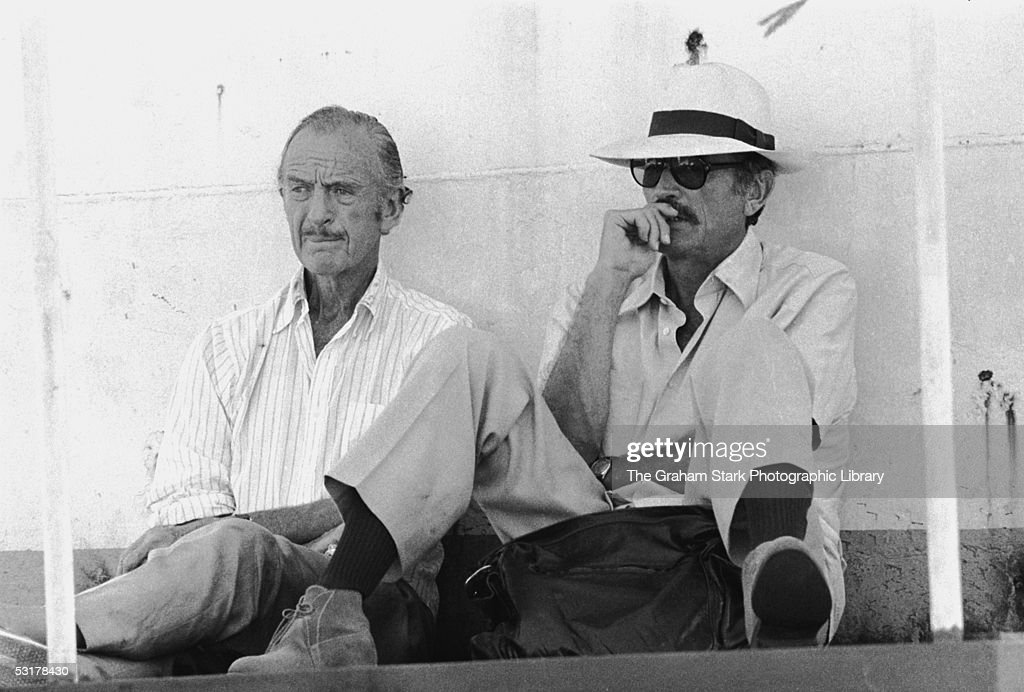 David Niven (1910 - 1983, left) and Gregory Peck (1916 - 2003) relaxing on the set of 'The Sea Wolves: The Last Charge of the Calcutta Light Horse', 1980.