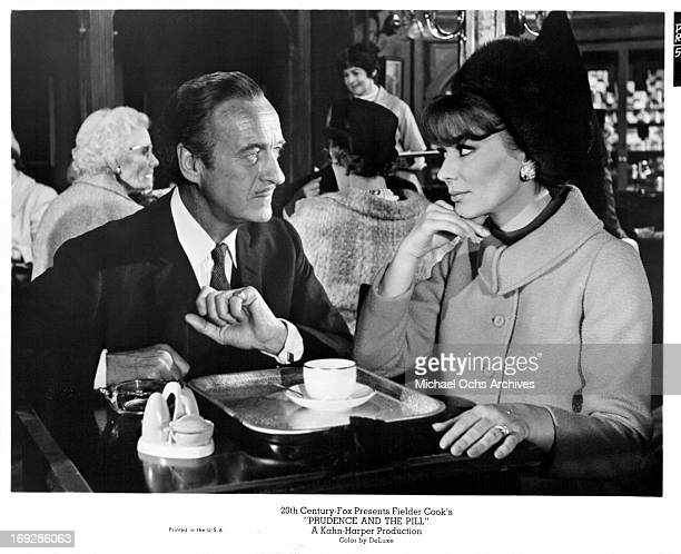 David Niven and Irina Demick have tea in a scene from the film 'Prudence And The Pill', 1968.