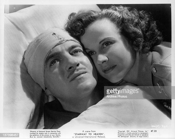 David Niven and Kim Hunter looking up from hospital bed in a scene from the film 'Stairway to Heaven' 1947