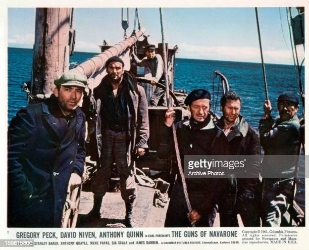 David Niven Gregory Peck Anthony Quayle and Anthony Quinn standing on a boat at sea in a scene from the film 'The Guns Of Navarone' 1961