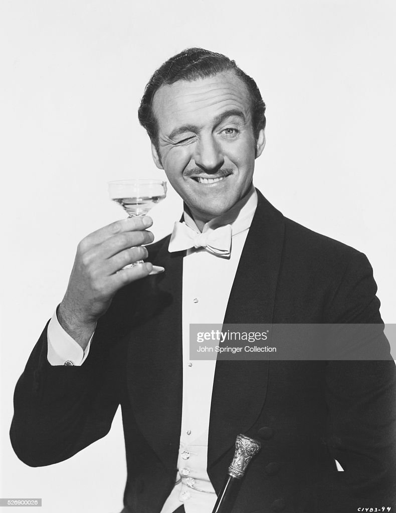 David Niven Holding a Martini Glass and Winking