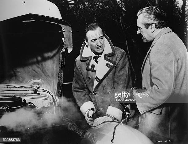 David Niven listens to John Le Mesurier in a scene from the MGM movie Where the Spies Are circa 1965