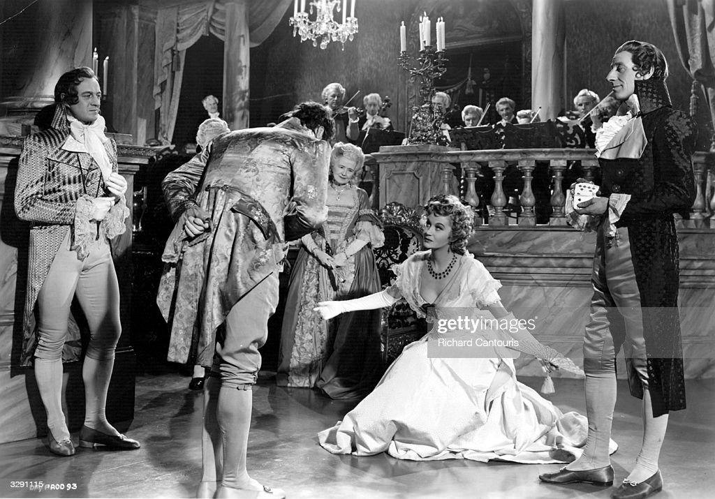 David Niven (1909 - 1983), Margaret Leighton (1922 - 1976), David Hutcheson (1905 - 1976) and Jack Hawkins (1910 - 1973) feature in 'The Elusive Pimpernel', an expensive film version of Baroness Orczy's classic novel. Also titled 'The Fighting Pimpernel', the film was directed by Michael Powell and Emeric Pressburger for London Films.